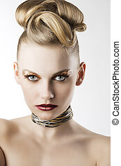 fashion girl with leopard makeup, she looks in to the lens -...
