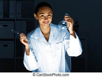 Young chemist working in laboratory