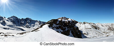 Mountain panorama - Panoramic mountain range in winter in...