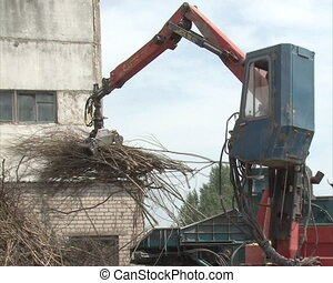 worker machine crush wood - special equipment with crane...