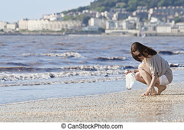 woman on the beach - young woman looking for the beautiful...