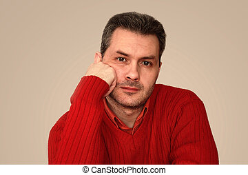 portrait of beautiful man in red sweater and shirt
