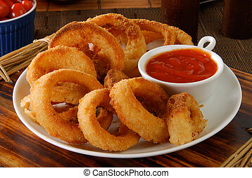 Onion rings - A plate of onion rings with catchup