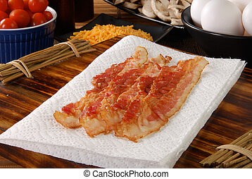 Bacon strips - Fresh cooked bacon strips with eggs,...