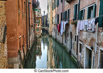 Canal, Venice Italy - Laundry drying above a canal in...
