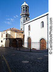 Bell tower - Several gates with arches, near a courtyard and...