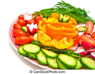 fresh vegetables on a plate on white background
