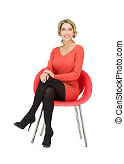 young businesswoman sitting in chair - picture of young...