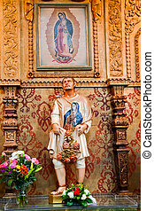 Guadalupe Shrine Mission Basilica San Juan Capistrano Church California. Mexican peasant Juan Diego Statue with Guadalupe on his tunic.