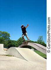 Skateboarder Grinding at the Skate Park