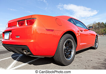 Orange Muscle Car - Rear close up of a modern orange sports...