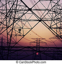 Abstract background of electricity pylons over purple...