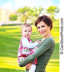 Mother and baby girl outdoor portrait
