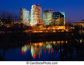 Sacramento skyline at night - Office building reflecting in...