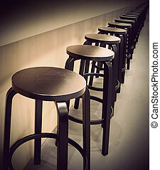 Bar stools in a row