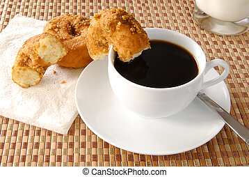 Coffee and doughnuts - A cup of coffee and doughnuts
