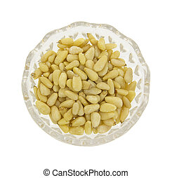 Pine nuts in glass dish