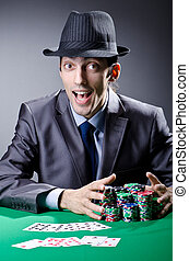 Casino player playing with chips