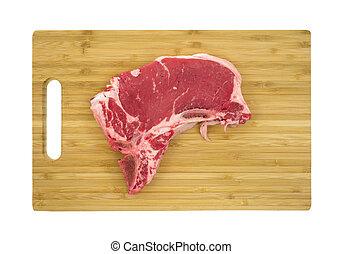 Fresh steak on wood cutting board