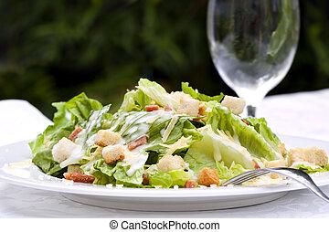Caesar Salad, served in a garden setting. Healthy al fresco...