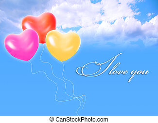 three inflatable heart shape balloons in cloud sky and LOVE...