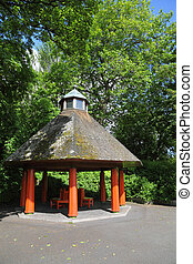 Arbor and trees in St. Stephen's Green at summer day in...