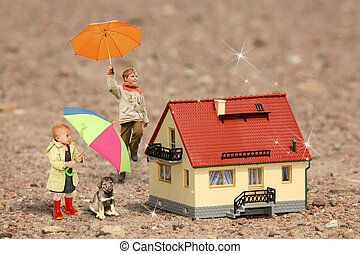 children with umbrellas, puppy and House model on ground collage