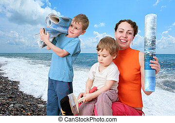 Children help mother to glue beach sea wall-papers collage