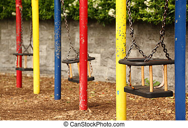 three empty teeter with chains, red, yellow, red, horizontal