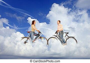bicycle couple man and woman meeting on dream white clouds collage