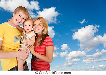 family with boy on White, fluffy clouds in blue sky collage