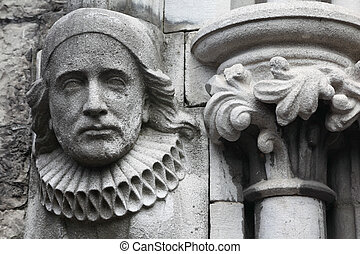old bas-relief made of stone in Christian Church, melancholy face