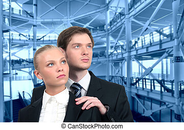 young business couple on industrial interior collage