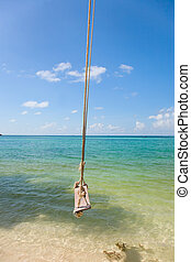 tropical beach with Old  Swing Tied to tree
