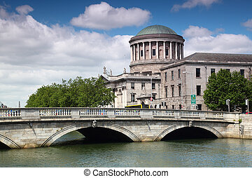 ODonovan Rossa Bridge and Four Courts, river Liffey in...