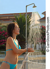 Young beautiful woman wearing in blue bathing suit takes...