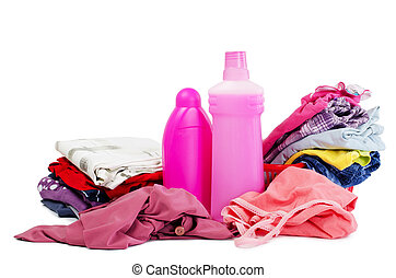 Heap of pure clothes with different detergent