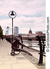monument to sailor on banks of River Liffey in Dublin,...
