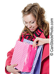 The beautiful girl with purchases