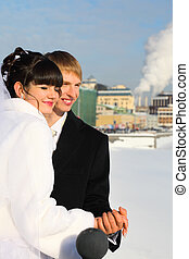 happy groom and bride holding hands at winter outdoors,...