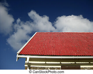 Tiled roof - damage tiled roof with blue sky and clouds