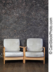 two white chairs in studio of photographer, brown background