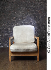 white chair in studio of photographer, brown background, front view