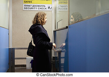 Young woman stands in the security checkpoint at the airport