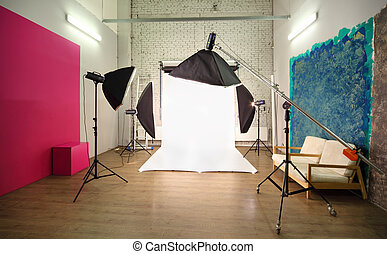 Multiple backgrounds inside studio - light room with lamps and spotlights