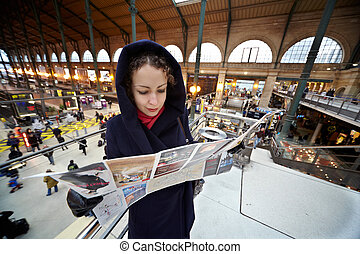 PARIS - DECEMBER 31: Young woman explores the map of Paris...
