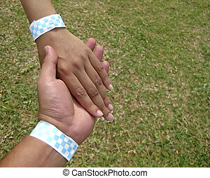 Young couple hands holding
