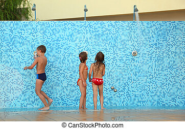 little brother and two sisters in bikinis taking shower...