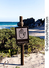 Restricted Area Sign at Beautiful Beach Portrait