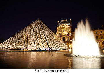 PARIS - JANUARY 1: Louvre Pyramid, fauntain and Pavillon...